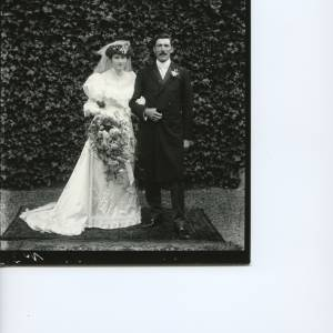 G36-018-04 Bride and groom in front of ivy-covered wall.jpg