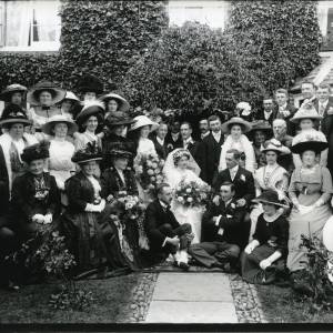 G36-024-02 Formal wedding group in garden in front of Thruxton Court.jpg