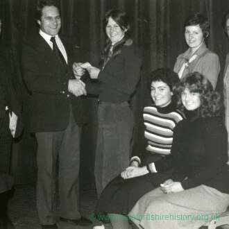 Group of people at a presentation, 5th January 1978