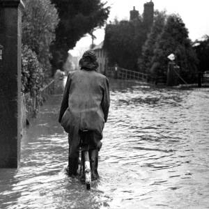 Cycling through floods in Herefordshire village.