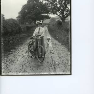 G36-019-03 Lady standing next to bicycle on country lane.jpg