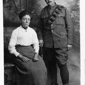 Soldier standing with lady sitting