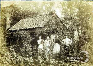 Commonside East: Mr Rice's Cottage with family