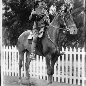G36-064-02 Soldier with rifle on horseback.jpg