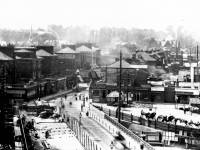 Wimbledon Bridge: Laying tram track near the station