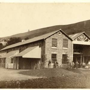 Farm buildings at Colwall showing spoil heap from shaft construction of Colwall tunnel
