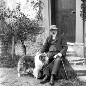 G36-542a-08 Mr. John Price of Pembridge sitting outside Court House with collie dog.jpg
