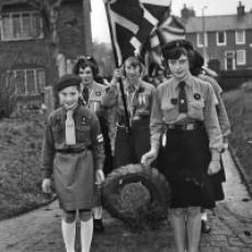 1961 Girl Guides and Brownies holding their wreath for the Remembrance Day Service