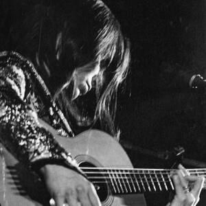 080 - Julie Felix playing guitar