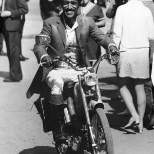 214 - Sammy Davis riding motorcycle