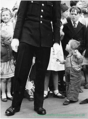 Policeman surrounded by children