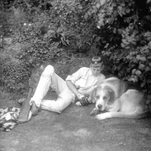 G36-468-01 Boy in cricket clothes next to a dog.jpg