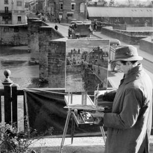 Trevor Makinson painting the view from the old bridge on the River Wye