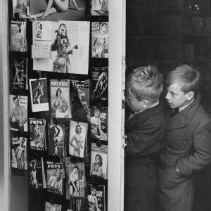 649 - Two Schoolboys peering at pin-ups in shop window