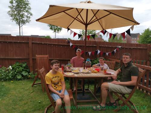 Garden tea party during lockdown to celebrate the 75th anniversary of VE day, 8 May 2020