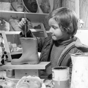 A young girl in a clay workshop. Goviev's child.