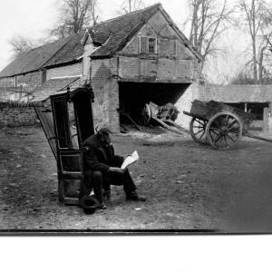 G36-326-05 Farm buildings and wagons. Mr Tomkins Hereford cattle fame seated.jpg