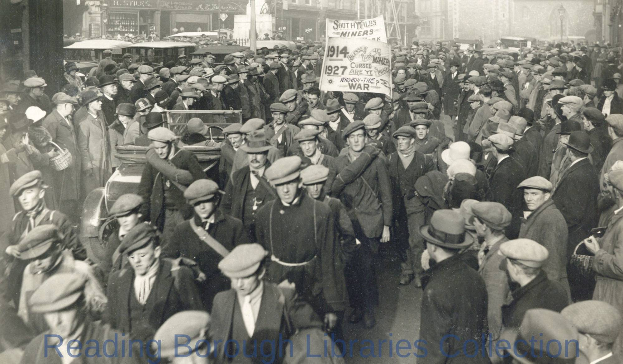 Unemployed Welsh miners marching through the Market Place in Reading, 17 November 1927.