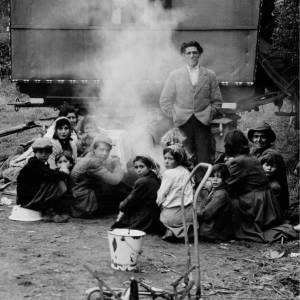 A Group of Romany Hop Pickers, Families of Butler Bros, Around a Camp Fire in Herefordshire