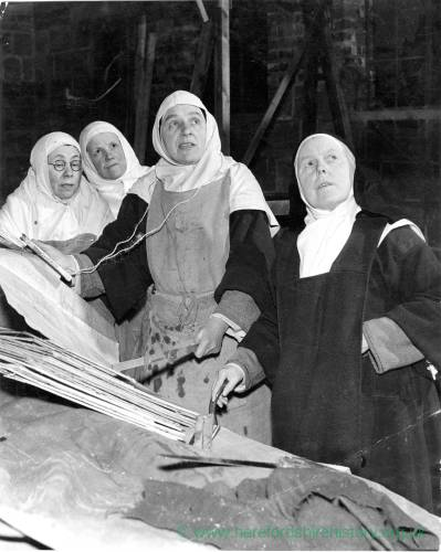 Nuns working on construction at their base