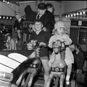 Children Ride a Small Carousel at Hereford May Fair, 1965