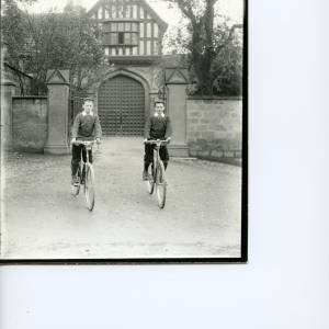 G36-022-02 Two boys on bicycles outside the Bishop's Palace, Hereford.jpg