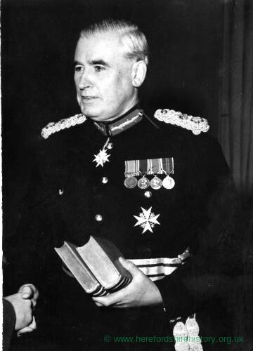 Unknown man in full military uniform.