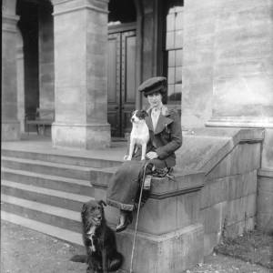 G36-246-05 Lady seated on steps of Holme Lacy House with two dogs .jpg