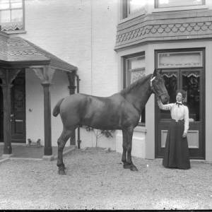 G36-300-02 Hunter outside Field Farm House with lady holding his head.jpg