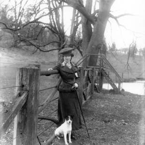 G36-246-10 Same lady as plate G36-246-01 et seq., leaning on a field gate with  dog.jpg