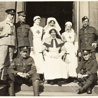 Sister, Nurses and Soldier Patients on Steps of Hospital Entrance