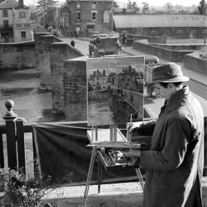 An artist working in Bridge Street, Hereford.