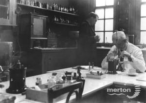 Nelson Hospital, Merton Park: Dr. Frank Deas working in the laboratory