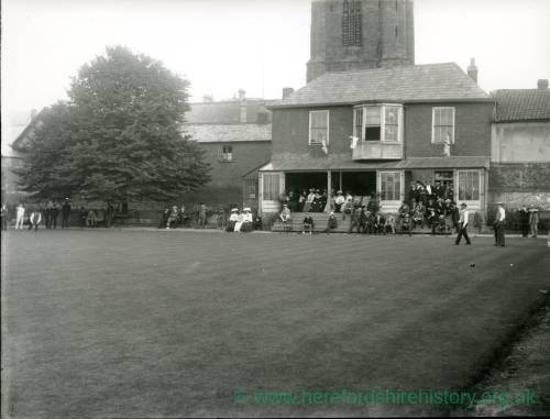 G36-216-02 Bowling Green clubhouse in Hereford, with All Saints Church tower seen behind.jpg