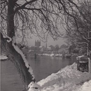 A snowy scene on the River Wye viewed from the bank at Bartonsham.