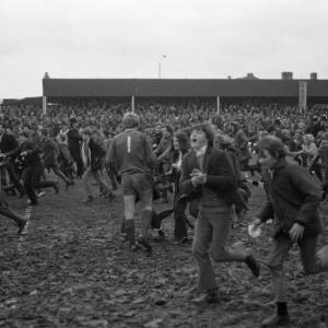 Fans on the pitch after Hereford United beat Newcastle, Feb 1972.