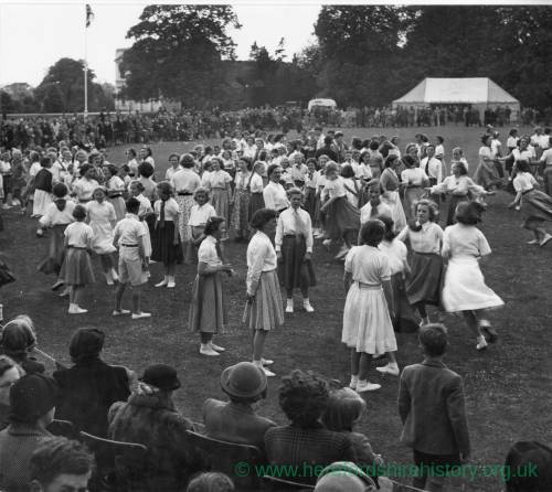 Crowds watch dancers on the Castle Green, Hereford