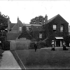 G36-540-02 Two ladies at croquet watched by older couple and two dogs.jpg