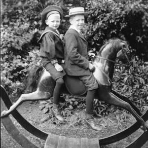 G36-029-05 Two boys on rocking horse.jpg