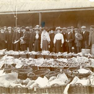 RGE035 - Formal photograph of a market. A man in the back has been blanked out of the photo. Perhaps 1880.jpg