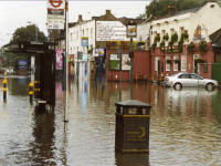 Flooding in Colliers Wood, Underground Station and the Royal  Standard pub