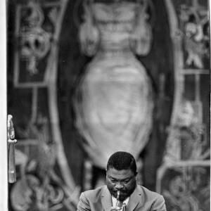 248 - Black musician playing trumpet, part of Duke Ellington's band