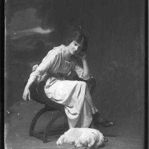 G36-107-10 Portrait of seated lady with terrier dog at her feet.jpg