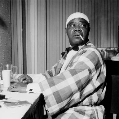 Louis Armstrong relaxing backstage, 1962.