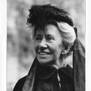 322 - Dame Flora Robson wearing costume and feathered hat.
