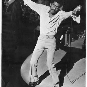 216 - Sammy Davis holding microphone and tambourine