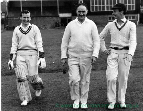 Three cricketers.