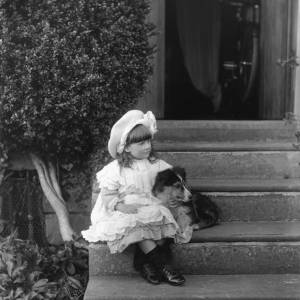 G36-251-06 Young girl seated on same  steps as G36-251-01 and -04, holding a small dog.jpg