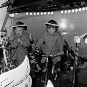 Children enjoying a ride at the May Fair Hereford, 1966