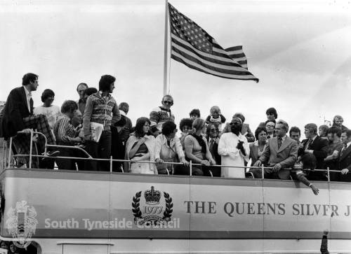 The open top bus parade on its way to South Shields